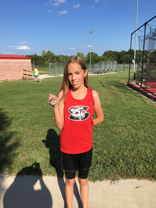 Tammara Williams medals in Stockton XC meet.
