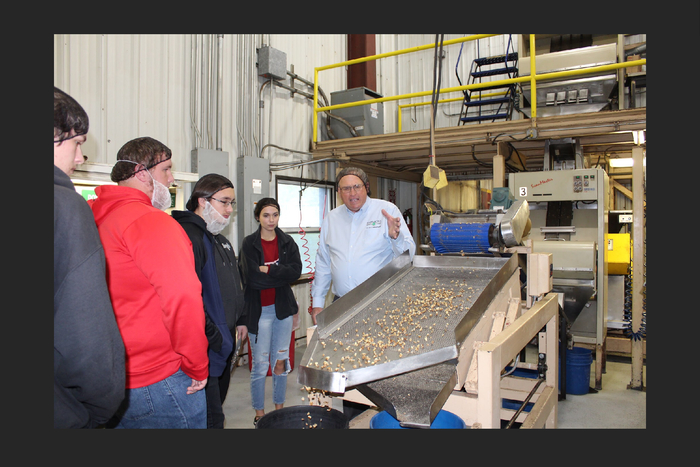 Steve Rutledge explains how the Black Walnuts are processed during the plant tour.