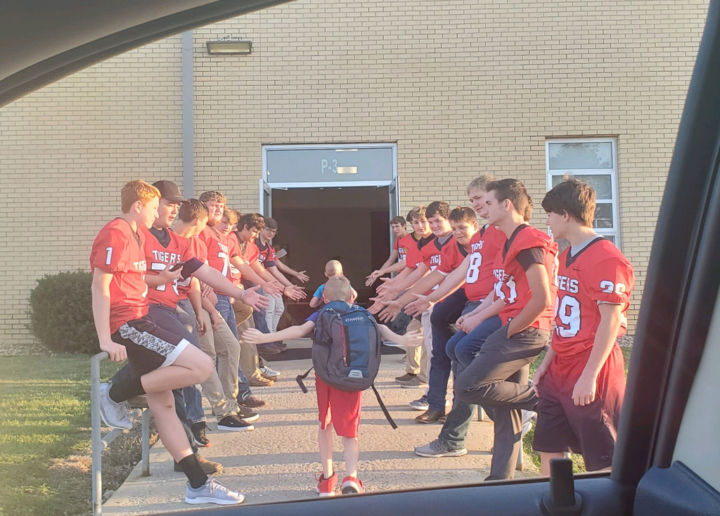 Football Tigers greet elementary students.