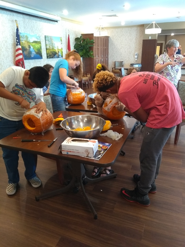 Carving pumpkins at the nursing home