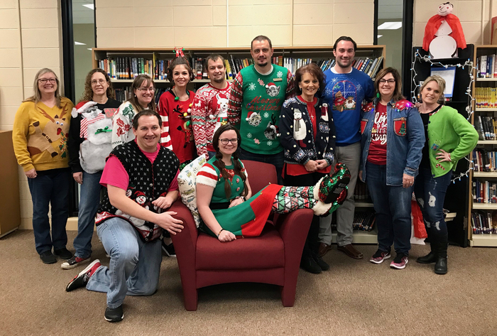 Middle School staff group picture with their ugly sweaters on.